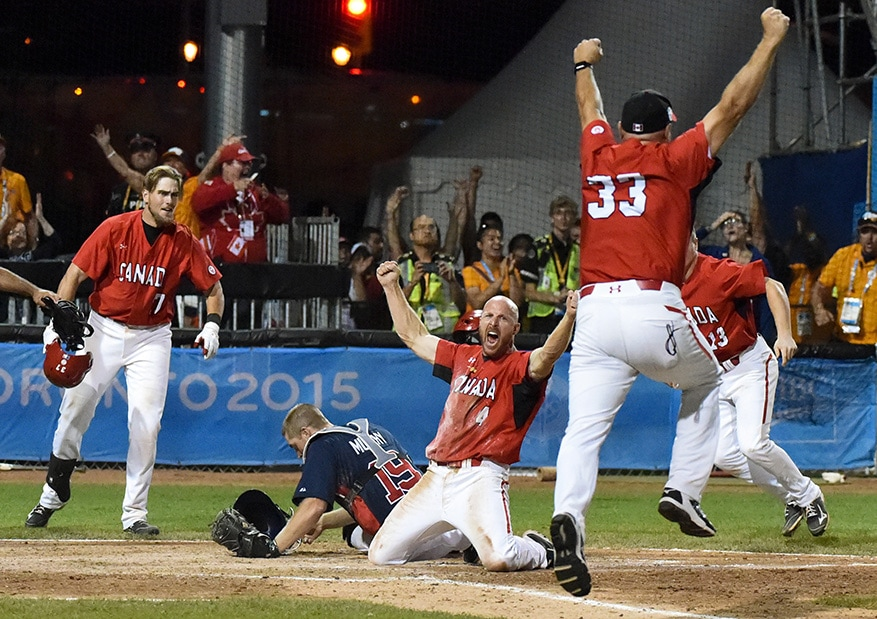 Peter Orr of team Canada scores the winning run to defeat the USA as part of the Pan Am Games