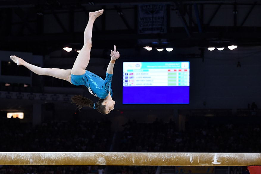 Isabela Onyshko of team Canada competes in the beam event of the Women's All Around Final at the Toronto Coliseum on Monday.