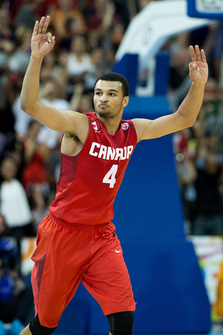 Jamal Murray of team Canada reacts to hitting a three pointer in the forth quarter against the United States in a semi-final men's basketball game as part of the Pan Am Games in Toronto.  Canada beat the United States 111-108 in overtime.