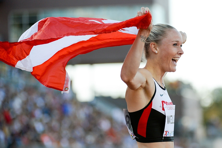 Sarah Wells of Canada reacts to finishing second in the women's 400m hurdles final on Wednesday at the CIBC Athletics Stadium as part of the Pan Am Games 2015 in Toronto.