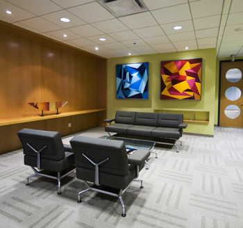 Interior of a luxury Toronto hotel lobby with modern designer furniture, paintings, and creative architecture