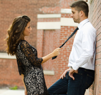 Beautiful woman poses with her fiance for an engagement photo