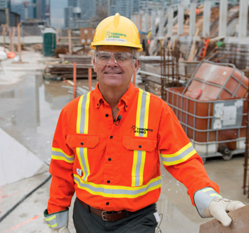 Toronto Hydro employee stands at a work site for a corporate promotional photo