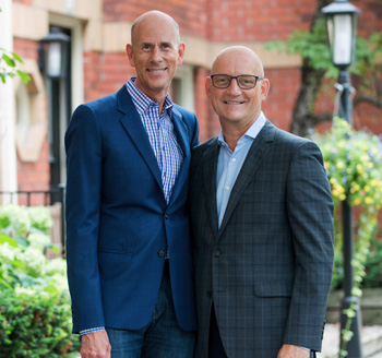 Two businessmen pose in downtown Toronto neighborhood for corporate portrait photo shoot