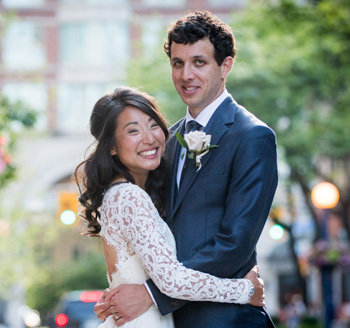 Couple pose for wedding photo in downtown venue
