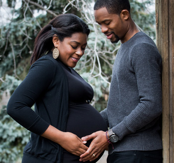 African american couple pose for a pregnancy photo during winter in Toronto