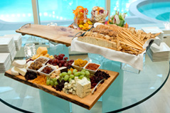 Photo of cheeses, fruits, and breads for a corporate event